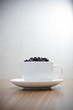 Coffee beans in white cup Royalty Free Stock Photos