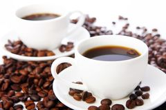 Coffee beans with white cups Royalty Free Stock Photos