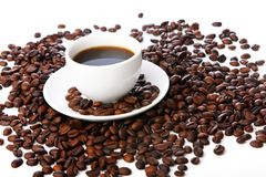 Coffee beans with white cups Stock Images