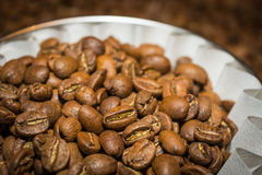 Coffee beans in white paper filter.  royalty free stock images