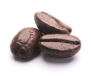 Coffee Beans On White. Some coffee beans are  on the white background Stock Image