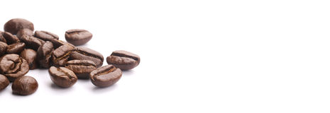 Coffee Beans On White. Some coffee beans are on the white background Royalty Free Stock Photos