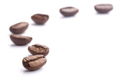 Coffee Beans On White. Some coffee beans are isolated on the white background stock photo
