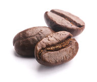 Coffee Beans On White. Some coffee beans are isolated on the white background stock photography