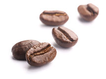 Coffee Beans On White. Some coffee beans are isolated on the white background Royalty Free Stock Image