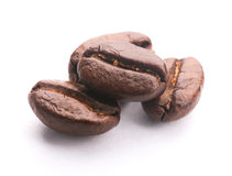 Coffee Beans On White. Some coffee beans are isolated on the white background royalty free stock photo