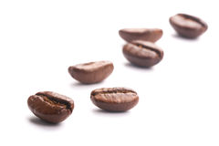 Coffee Beans On White. Some coffee beans are isolated on the white background royalty free stock images