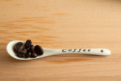 Coffee beans with white spoon Stock Photo