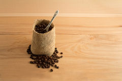Coffee beans with white spoon Royalty Free Stock Photo