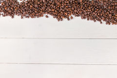 Coffee beans white table Royalty Free Stock Images