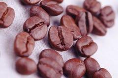 Coffee beans on white textile Stock Image
