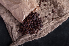 Coffee beans woke up from package Royalty Free Stock Photography