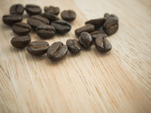 Coffee beans on wood Stock Image
