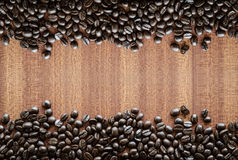Coffee beans on wood background Royalty Free Stock Photography