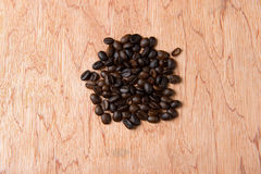 Coffee beans on wood background Stock Images
