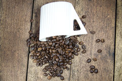 Coffee beans on wood Stock Photos