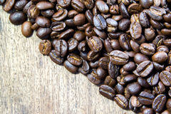 Coffee beans on wood Royalty Free Stock Photo