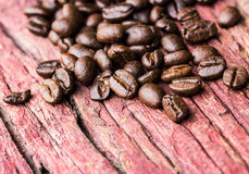 Coffee beans on wood Royalty Free Stock Photos