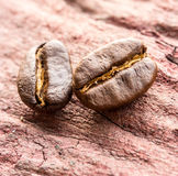 Coffee beans on wood Royalty Free Stock Images