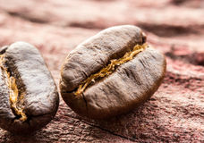 Coffee beans on wood Royalty Free Stock Photography