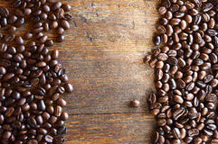 Coffee beans. On wood background Stock Photos