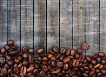 Coffee beans and wood background stock images