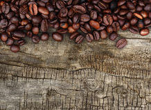 Coffee beans and wood background stock image