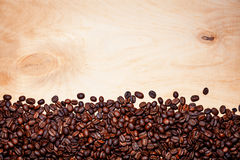 Coffee beans. On wood background Royalty Free Stock Photography