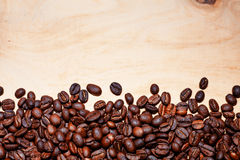Coffee beans. On wood background Royalty Free Stock Images