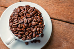 Coffee beans. On wood background Stock Photo