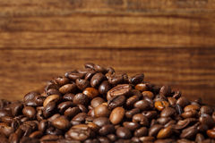 Coffee beans on wood background. Close-up Stock Image