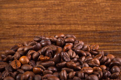 Coffee beans on wood background. Close-up Royalty Free Stock Images