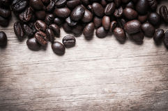 Coffee beans on wood background Stock Photography