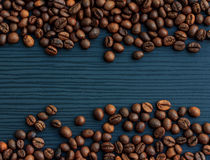 Coffee beans on wood background Stock Photos