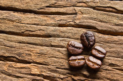 Coffee beans on wood background Royalty Free Stock Image