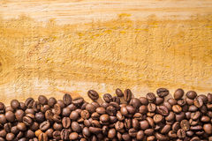 Coffee Beans and Wood Royalty Free Stock Photos