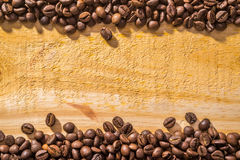 Coffee Beans and Wood Royalty Free Stock Photo
