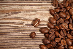 Coffee beans on wood background Royalty Free Stock Photo