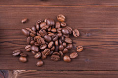 Coffee beans on wood background. Roasted coffee beans on wood background Royalty Free Stock Images