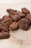 Coffee beans on wood background Royalty Free Stock Images