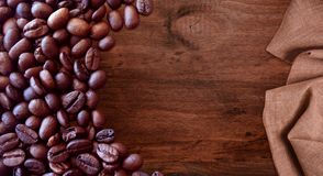 Coffee beans on wood background vintage style for graphic design. Food and drink stock photo
