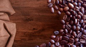Coffee beans on wood background vintage style for graphic design. Food and drink royalty free stock photos