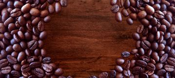 Coffee beans on wood background vintage style for graphic design. Food and drink royalty free stock photo