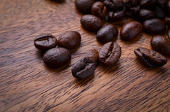 Coffee beans on wood background Stock Image