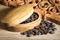 Coffee beans with wood carve Stock Photography