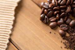 Coffee Beans on Wood Close Up Stock Photos