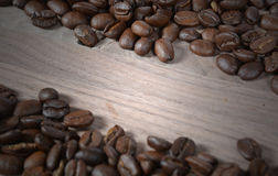 Coffee beans on wood Stock Photography