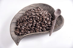 Coffee beans. On wood dish Royalty Free Stock Images