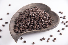 Coffee beans. On wood dish Royalty Free Stock Photo