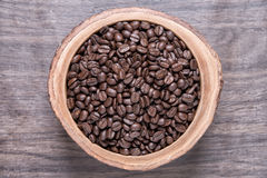 Coffee beans. On wood dish Royalty Free Stock Photography